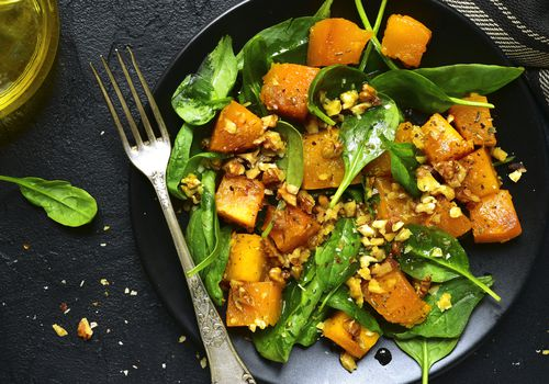 Roasted pumpkin salad with spinach and walnut