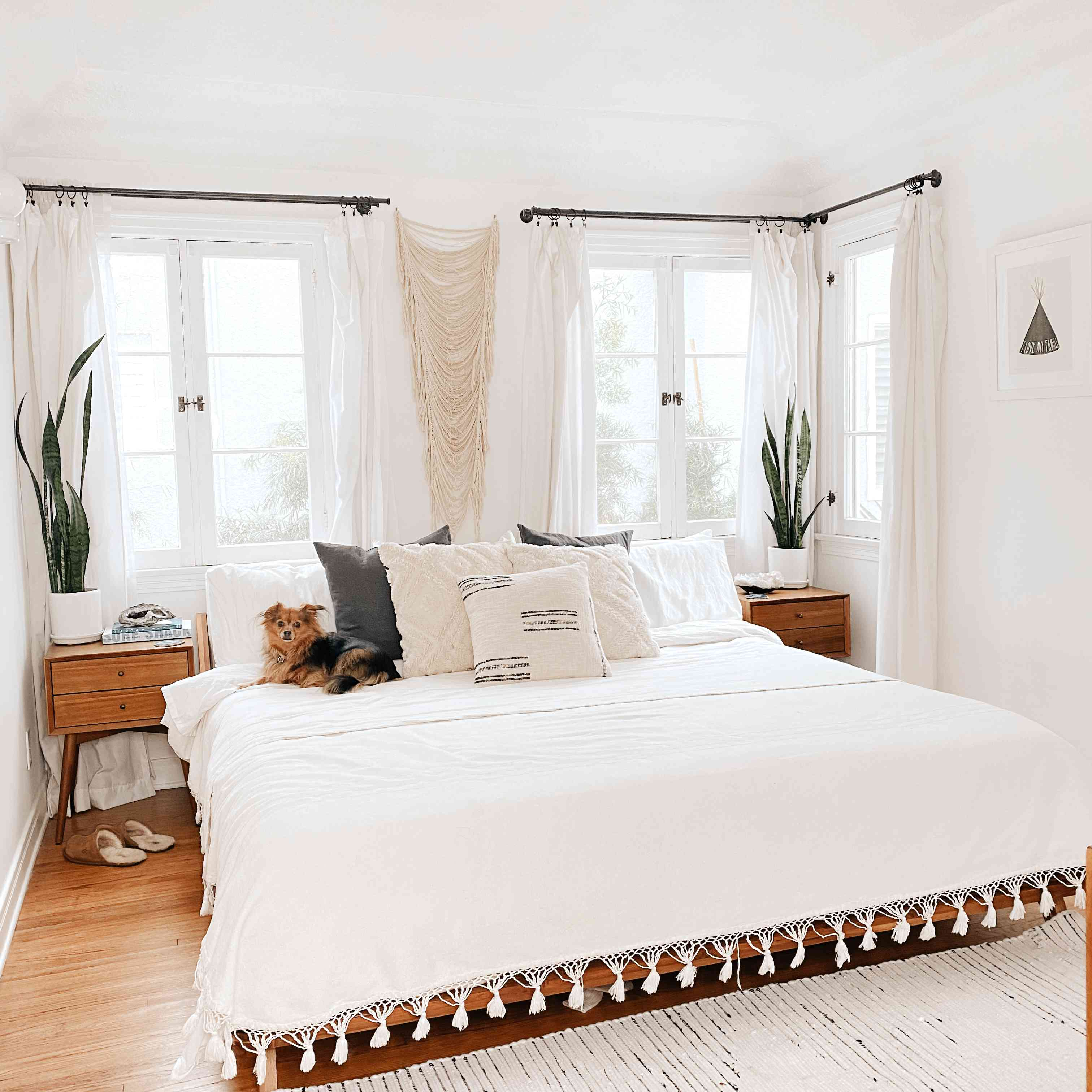 White bedroom with detail rug