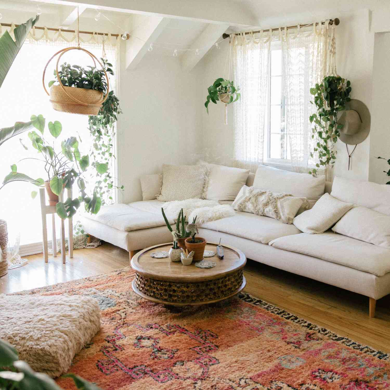 A room with a white couch and a printed rug