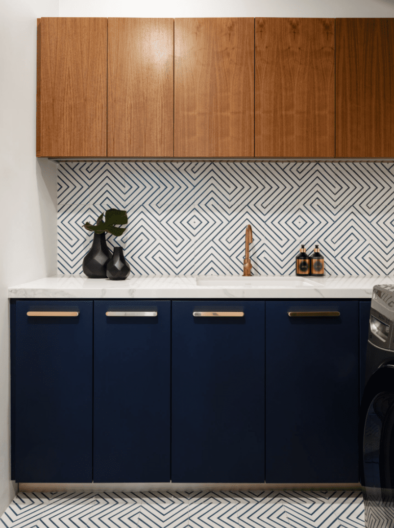 A kitchen with a printed backsplash and matching floors