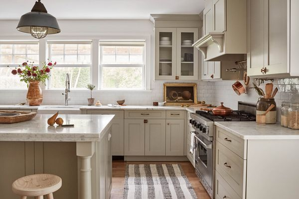 Luxe beige farmhouse kitchen with grey and white striped runner