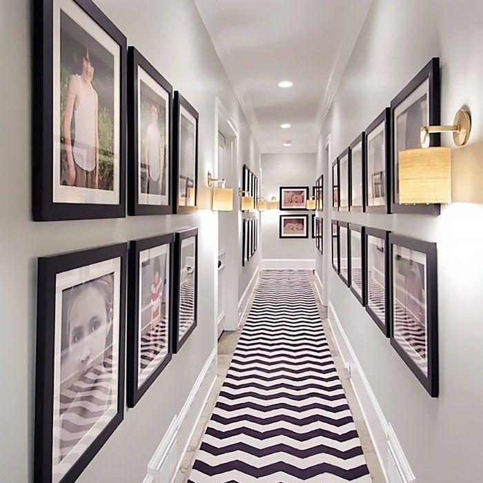 Nate Berkus remodel: hallway with walls of photos