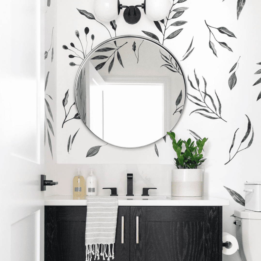 A bathroom with minimalist wallpaper on the walls