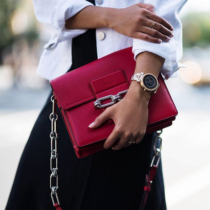 a woman holding a purse