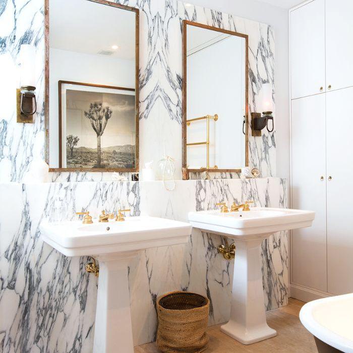 an elegant bathroom with twin sinks