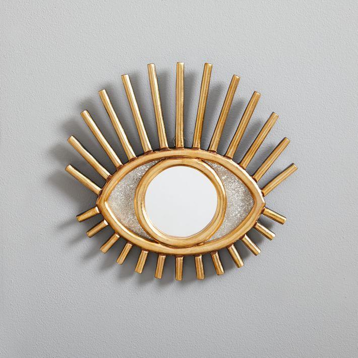 gold eye mirror