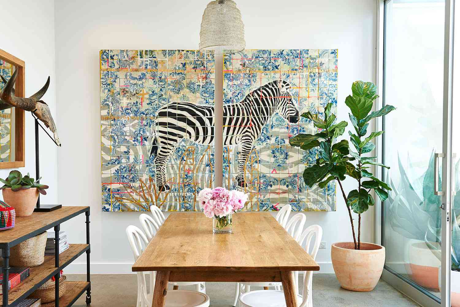 Beach-y dining room with painted zebra diptych wall decor