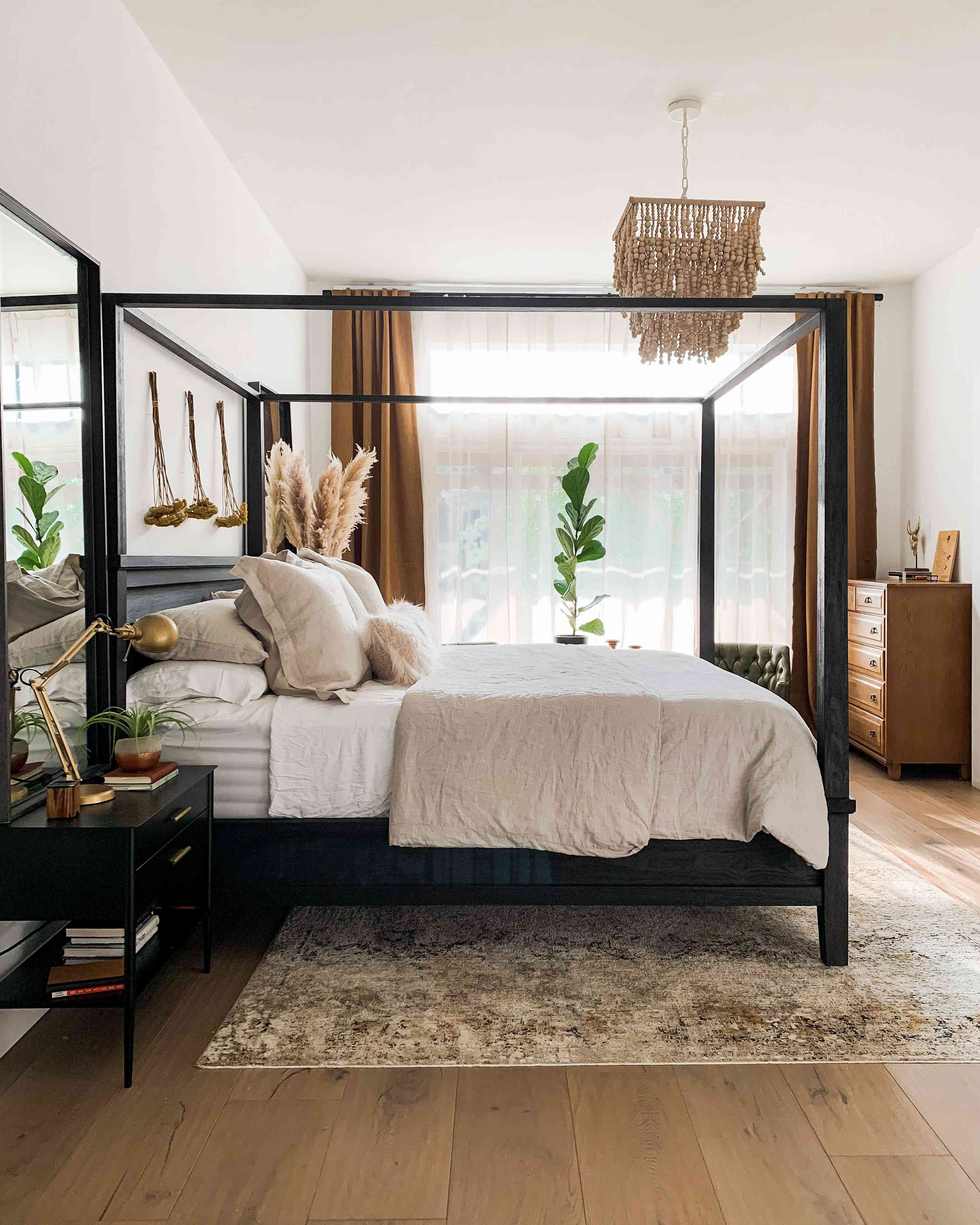 Bedroom with black bed
