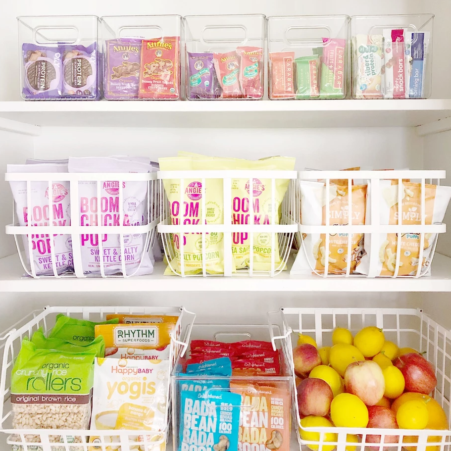 Organized pantry with white wire bins.