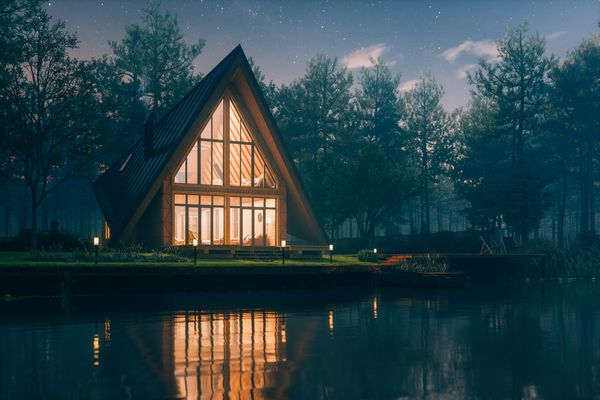 A lakeside chalet house at night