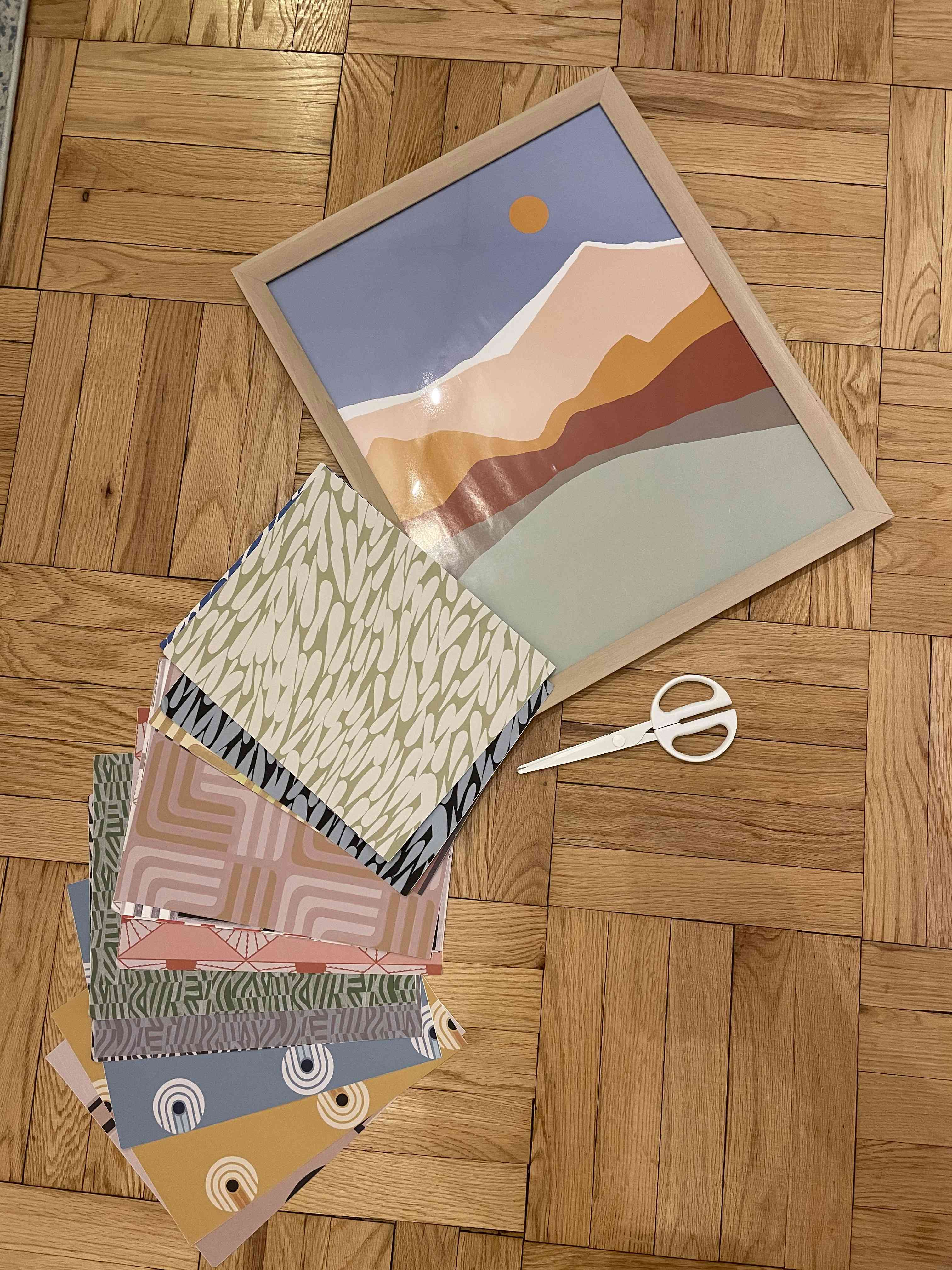 gather your supplies - wallpaper, scissors, empty frame