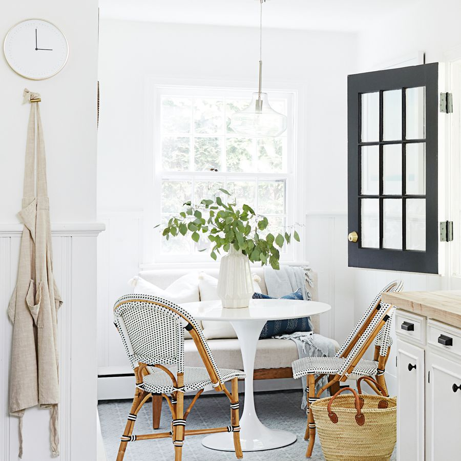 Breakfast nook with white and blue bistro chairs
