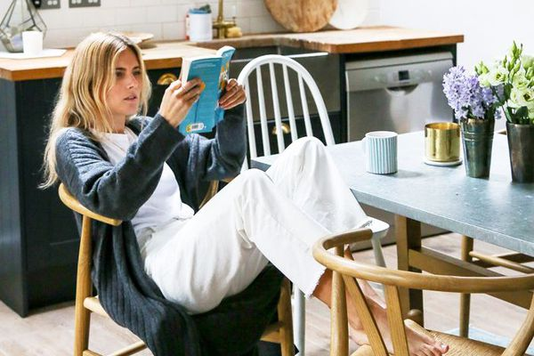 a woman reading in the kitchen