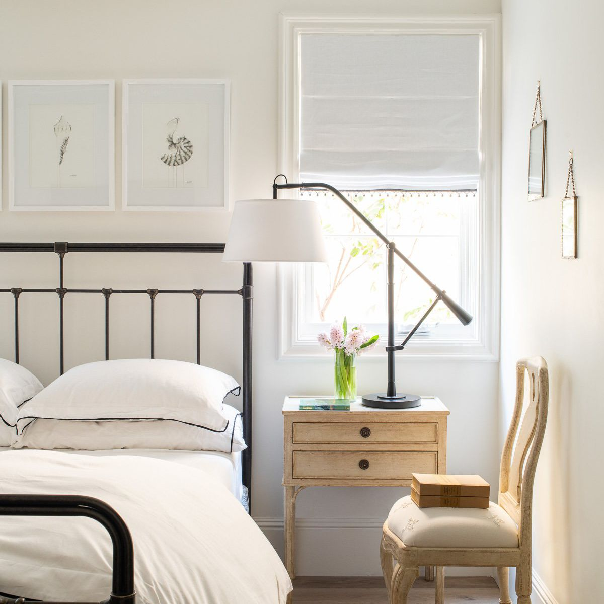 A light-filled bedroom with off-white walls