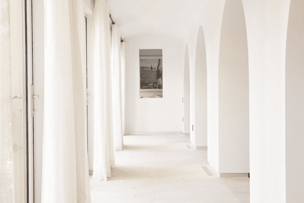 how to clean walls - bright white walls in open hallway
