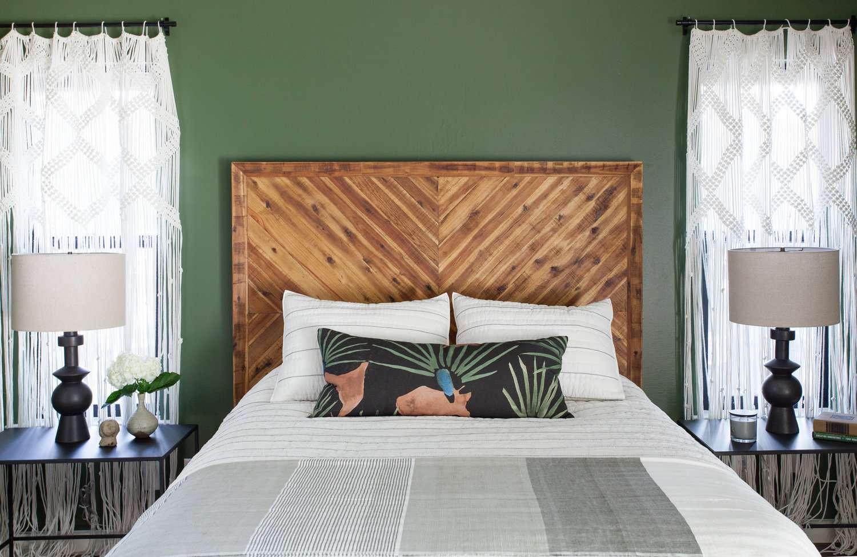 A tropical bedroom with deep green walls
