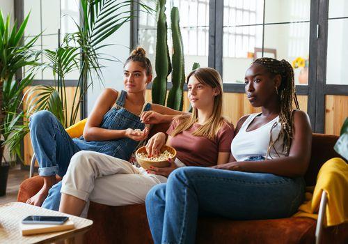 Three girls watching movie.