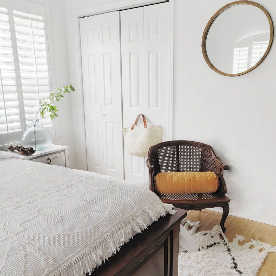 Bedroom with wicker chair