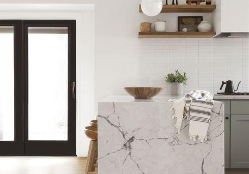Marble waterfall countertop in Mid-Century style kitchen