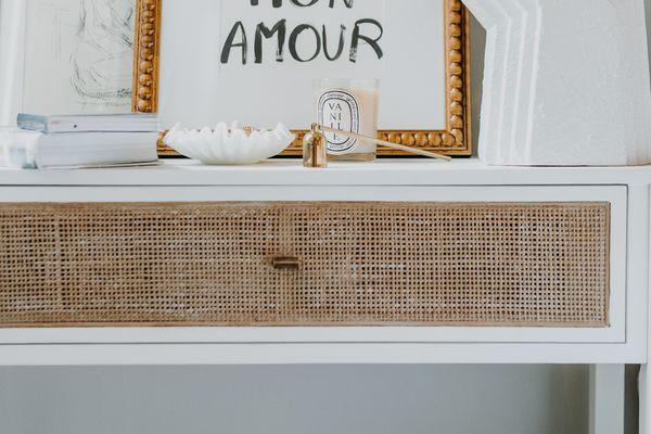 Nightstand with French decor accents.