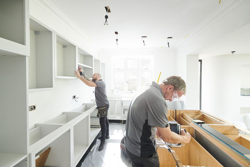 joinery team fitting a kitchen