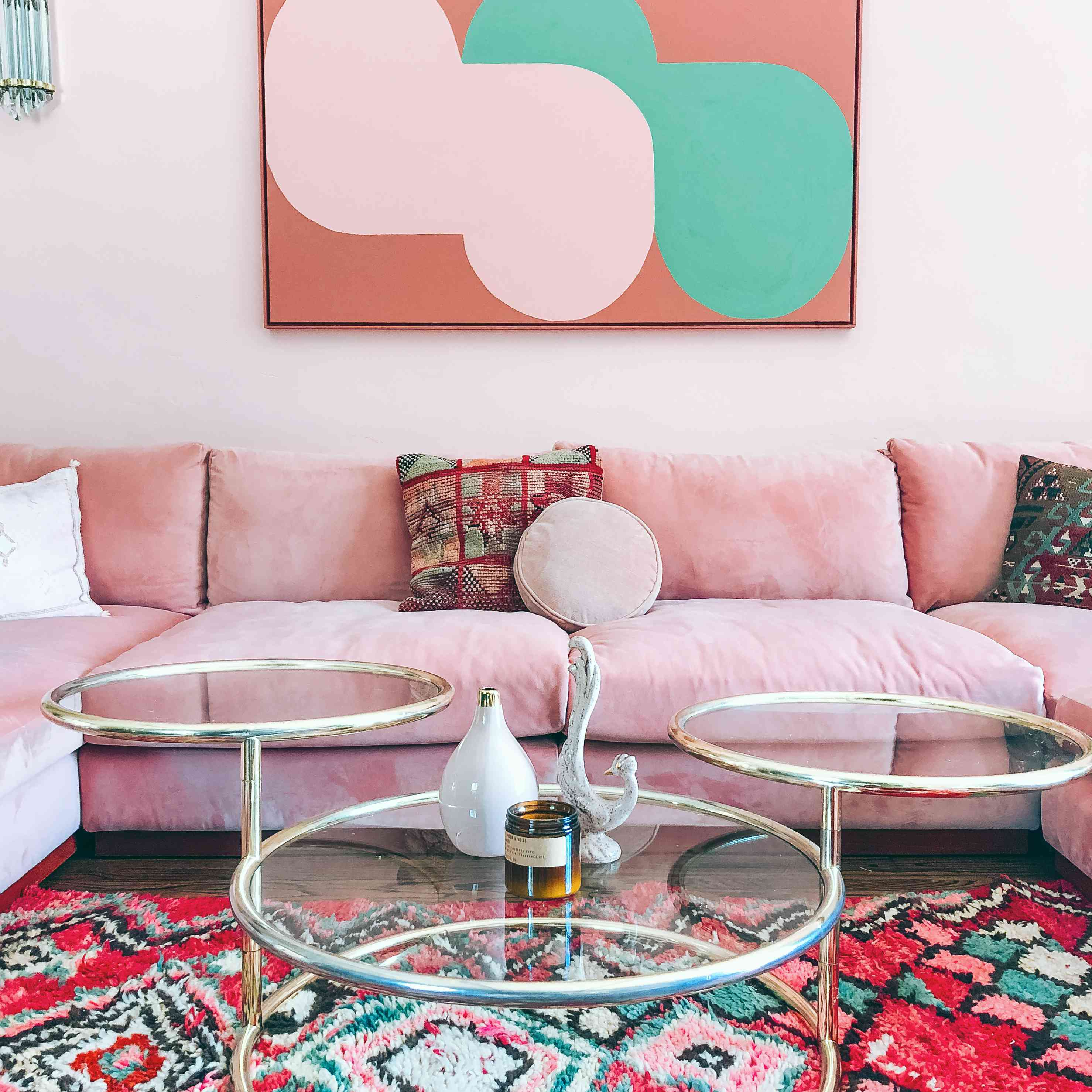An all-pink living room with midcentury vibes.