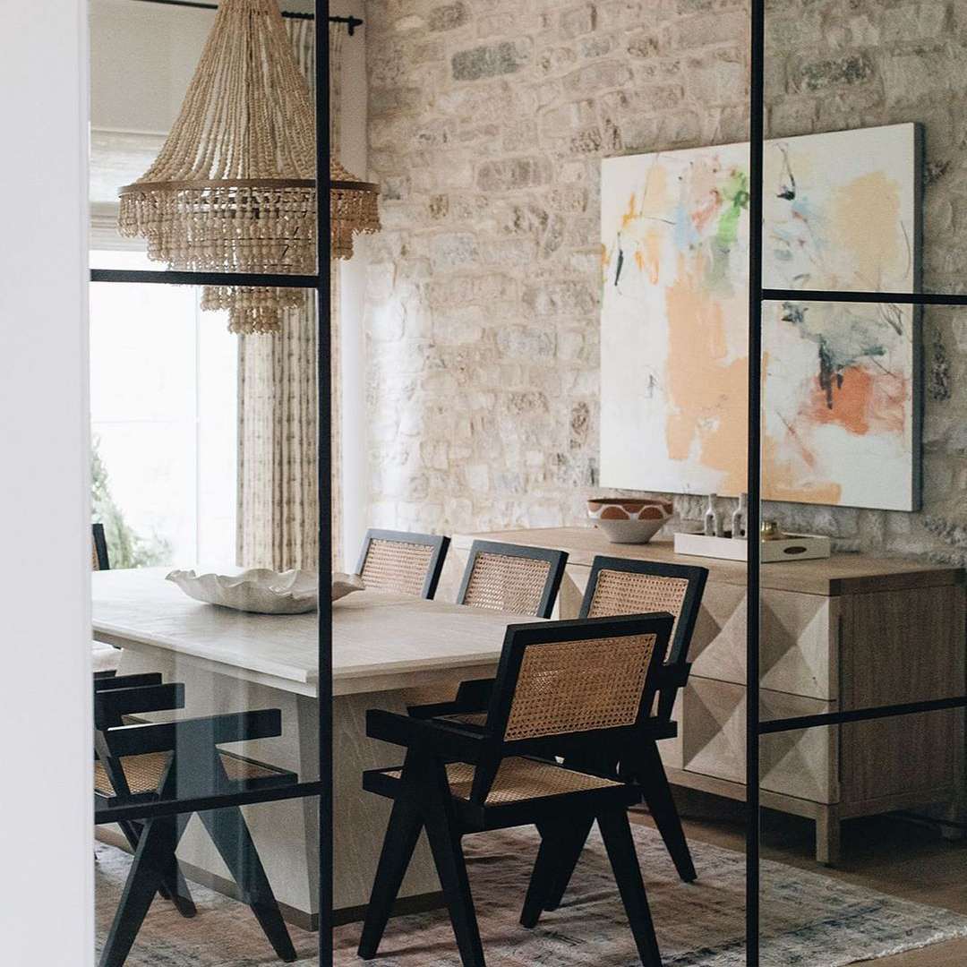 dining room with textured light fixture and floating armchairs