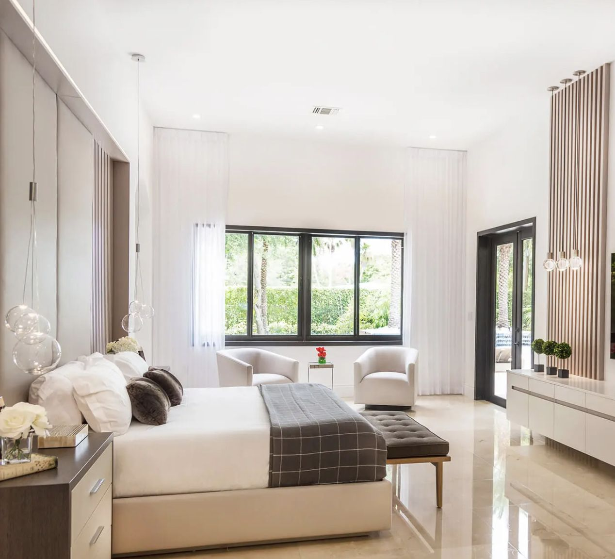 bedroom with neutral color scheme, long white curtains hanging from ceiling