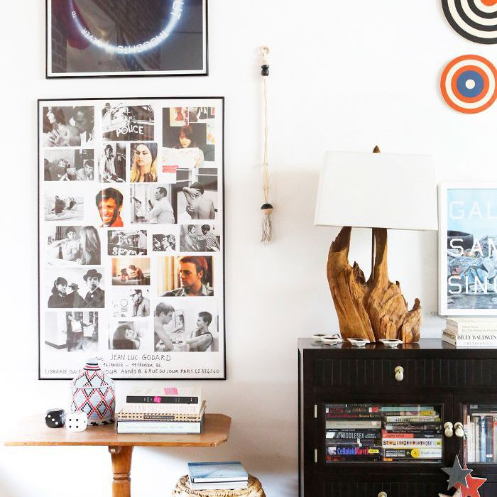 Easy Cozy Home Advice: A collage of artwork adorns a white wall