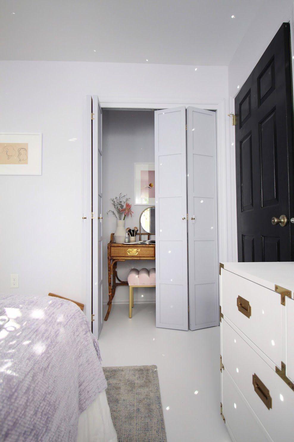 A bedroom with lavender walls and a lavender closet door