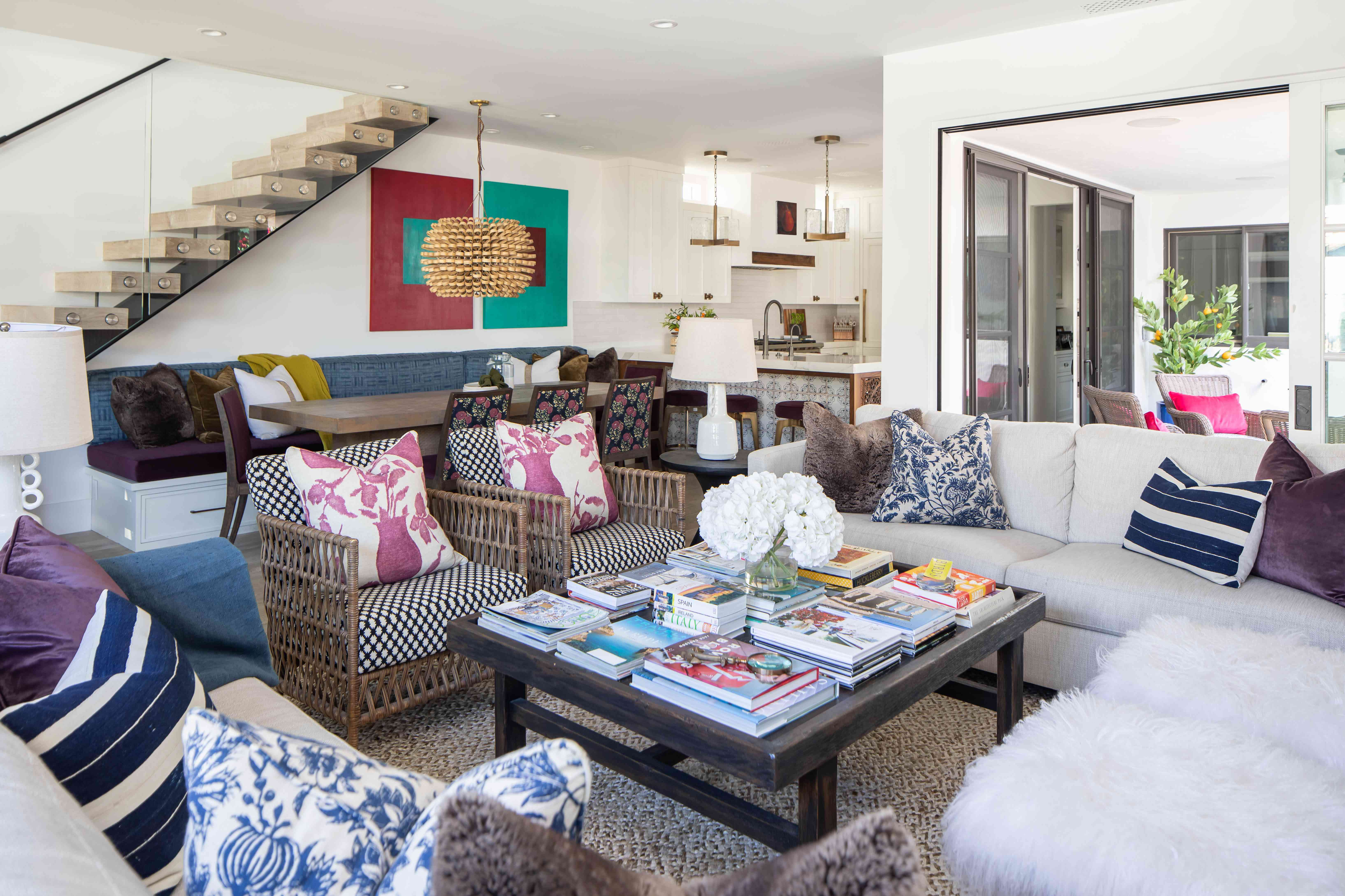 Eclectic living room with coffee table filled with books.