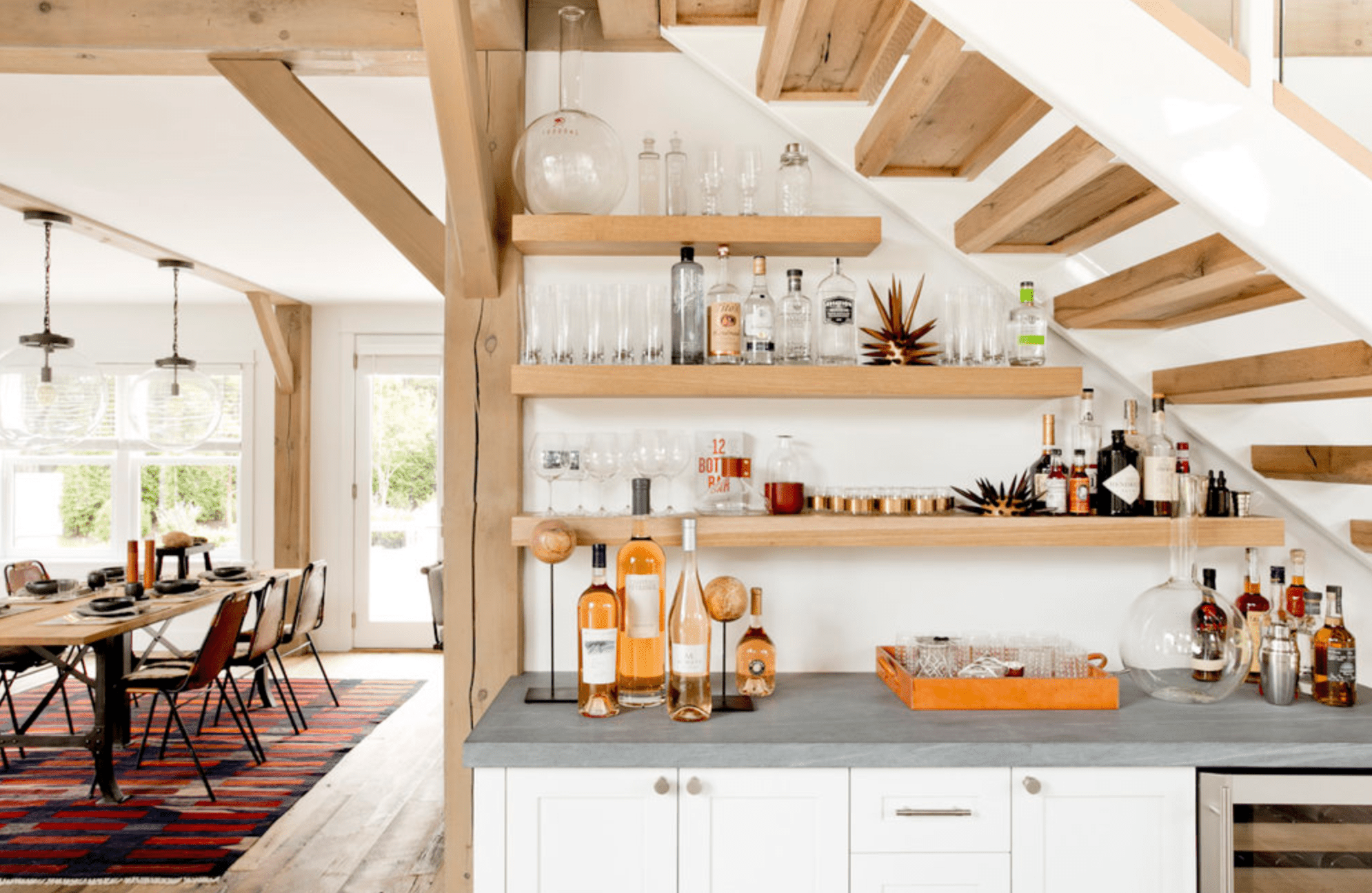 A wall under a staircase that's been turns into a wet bar