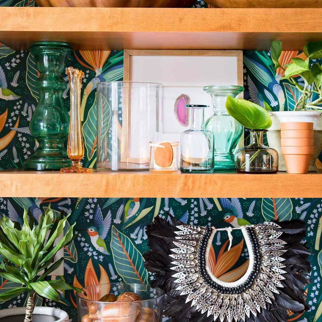 Shelves with wallpaper behind it