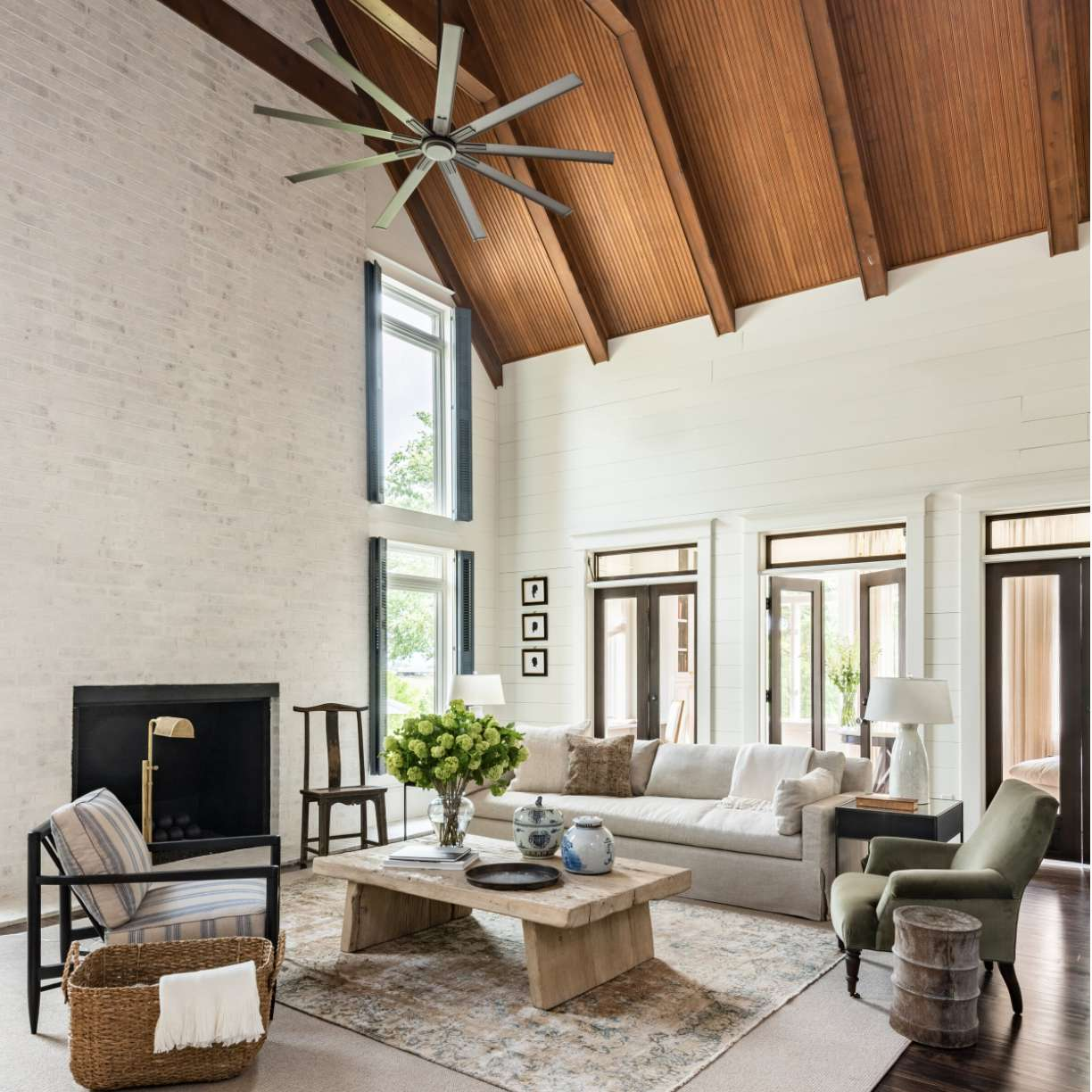 living room with white painted brick accent wall