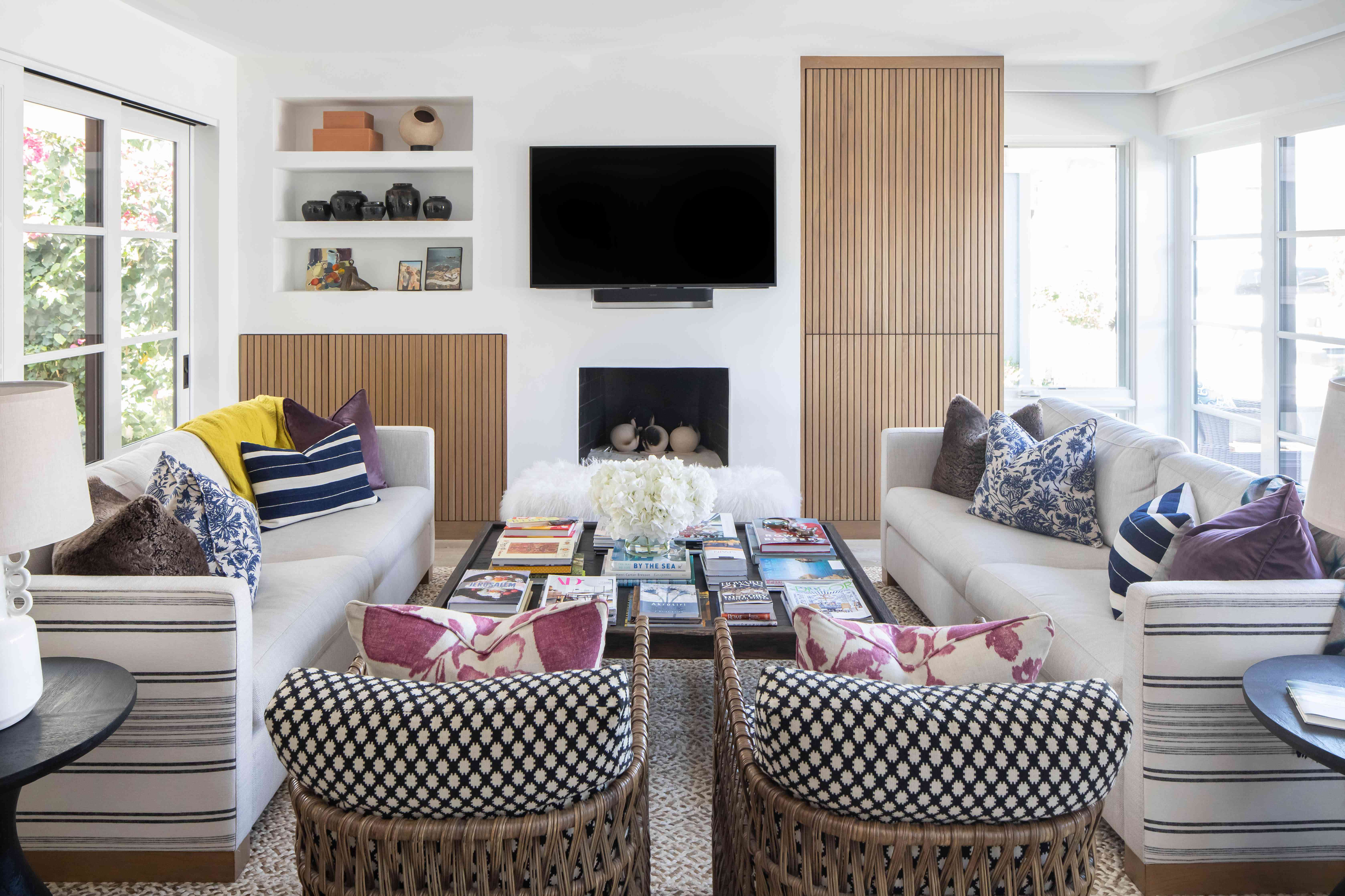 Coastal living room with wooden panels and two sofas.