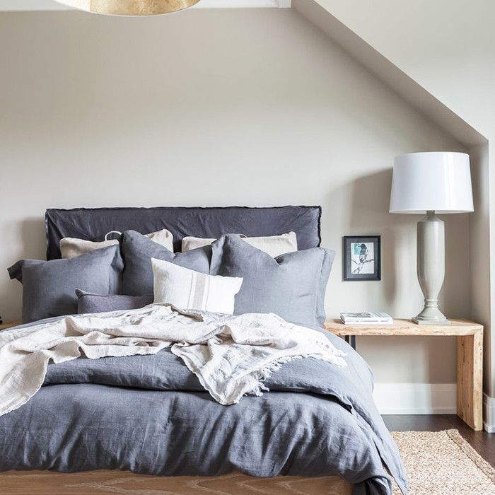 a bedroom with Target Home bedding and furniture