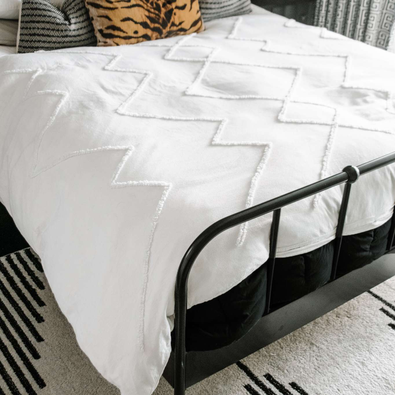 White comforter on bed.