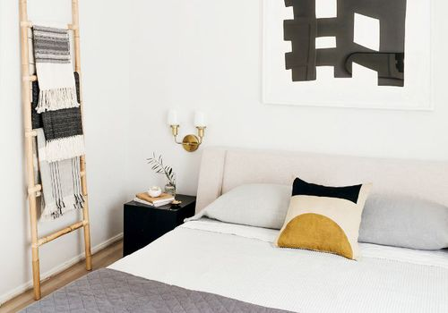 Bedroom with black, white, and yellow color palette.