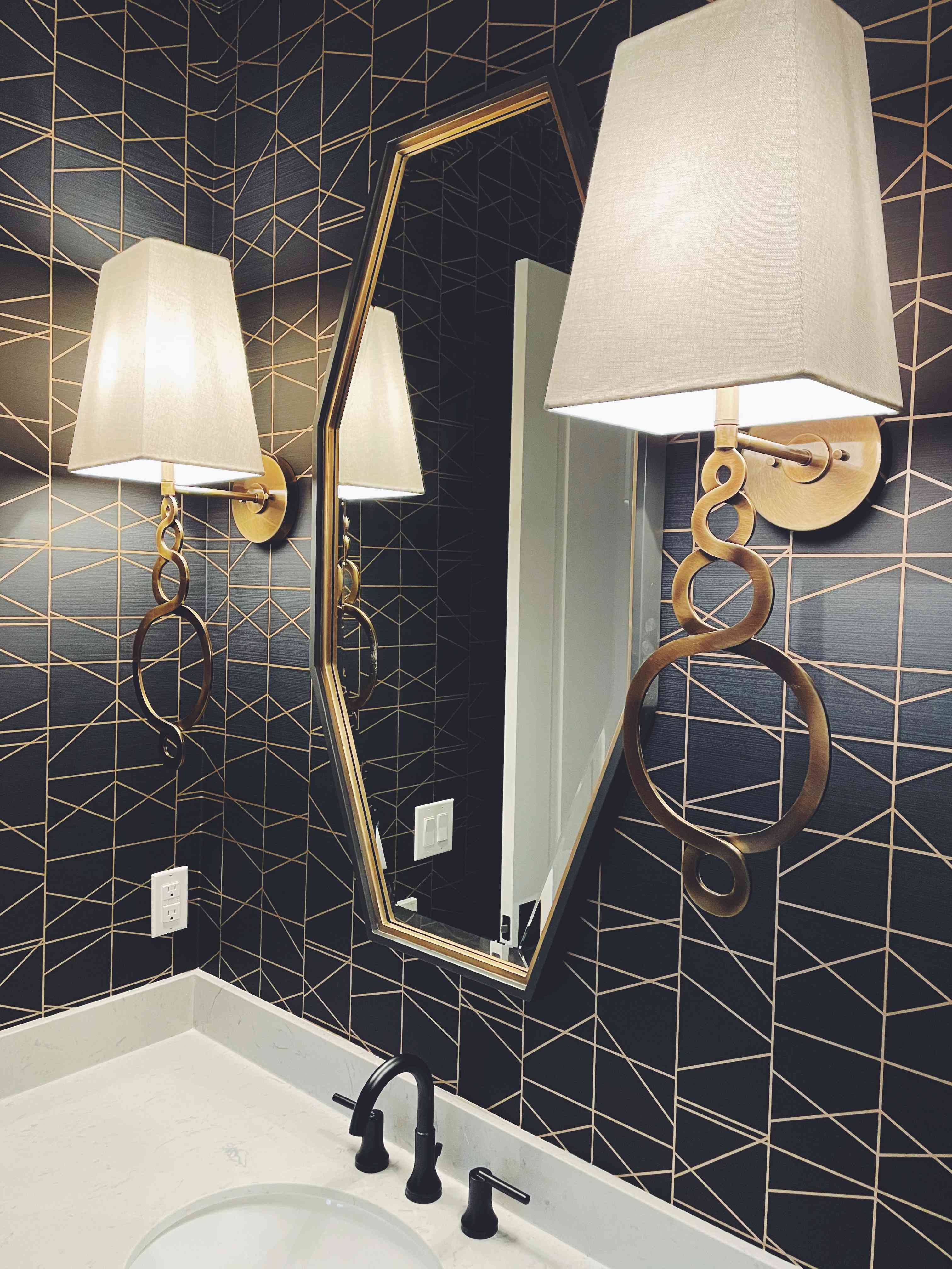 Bathroom with luxurious wall sconces.