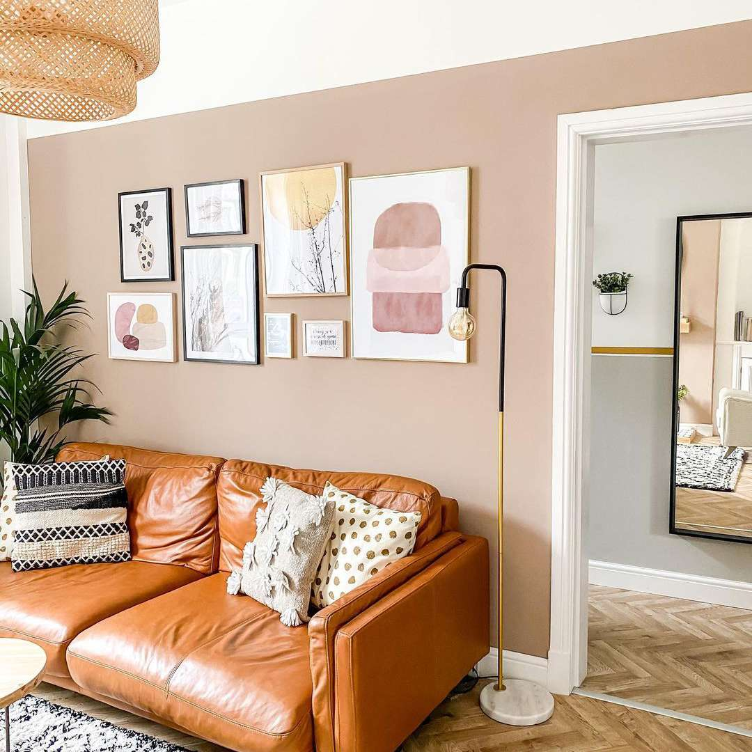 Rose accent wall in neutral living room.
