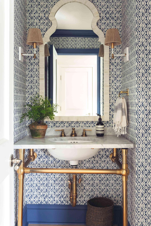 Floor to ceiling patterned tiled bathroom
