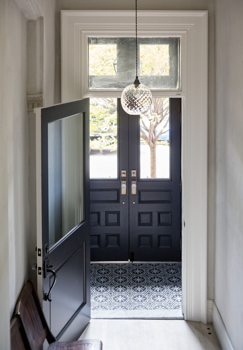 entryway with blue pattern decorative tile