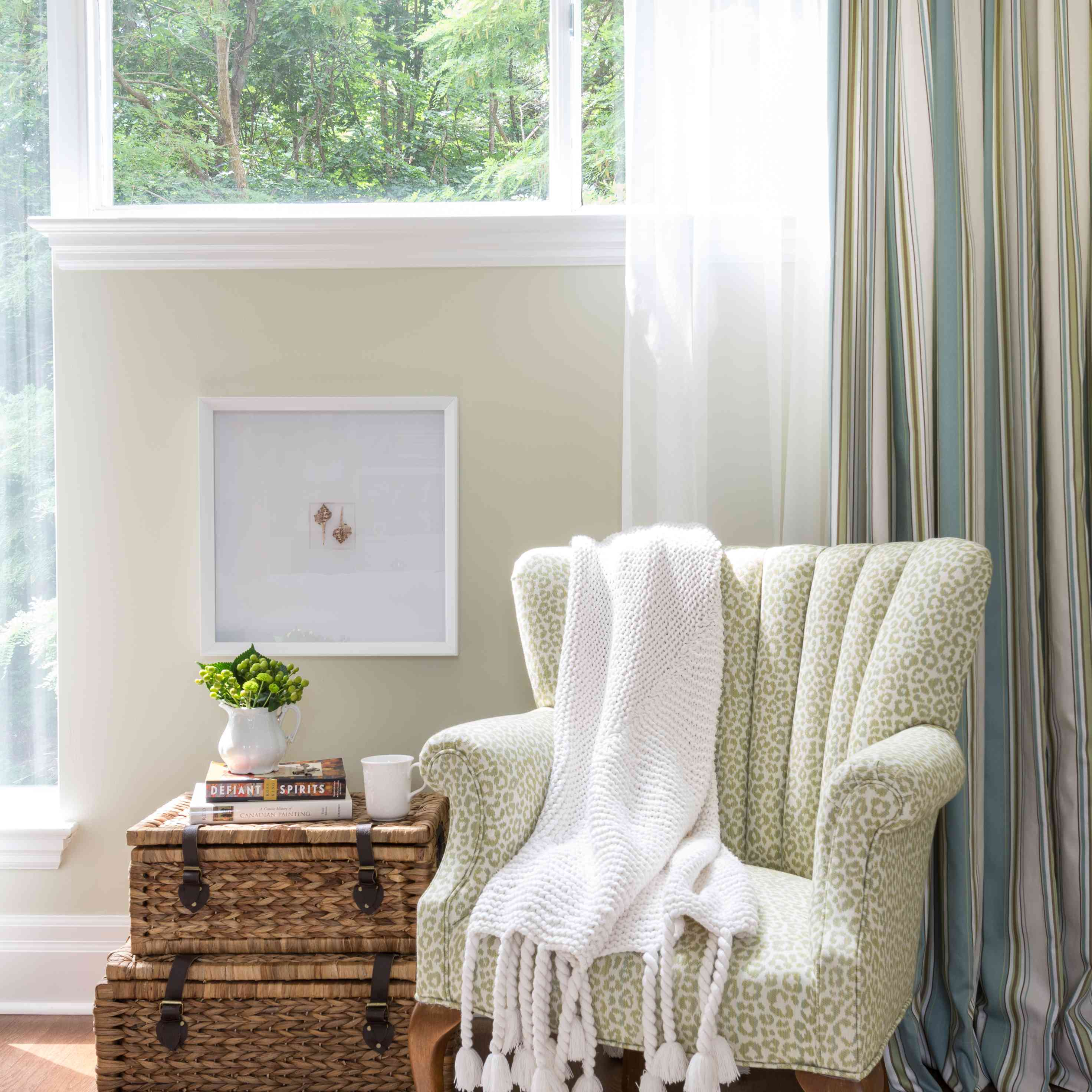 how to decorate sustainably - vintage chair next to wicker suitcases