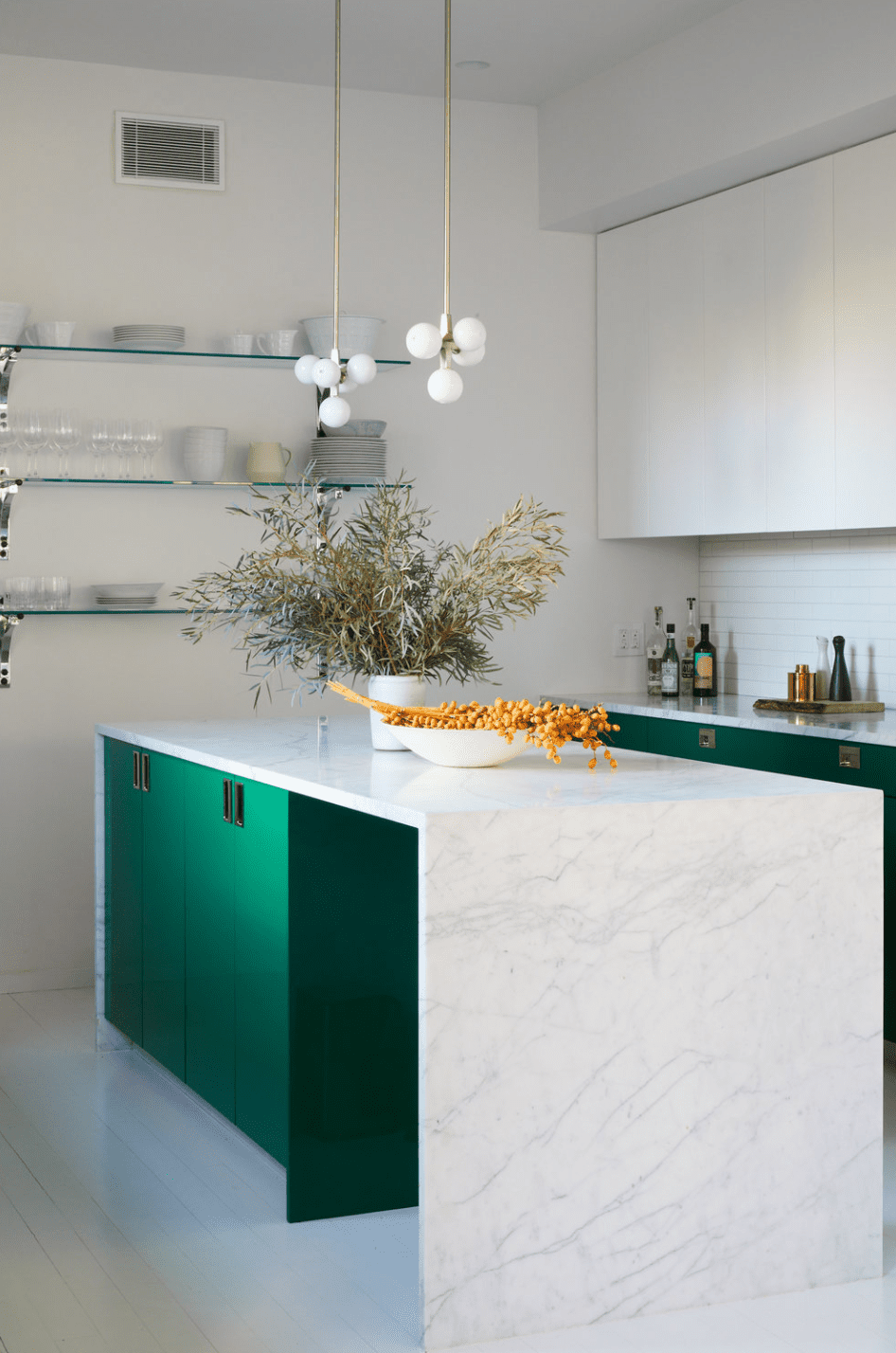 A marble-lined kitchen with custom IKEA cabinets