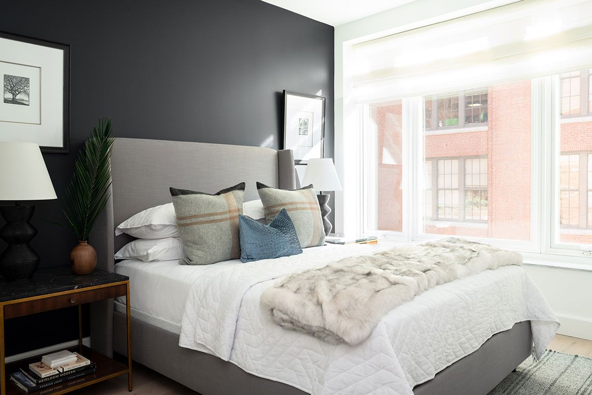 Cozy bedroom with navy blue accents