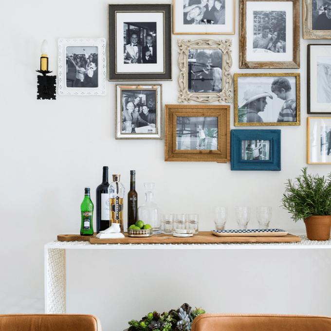 A gallery wall with a combination of sleek and ornate mirrors