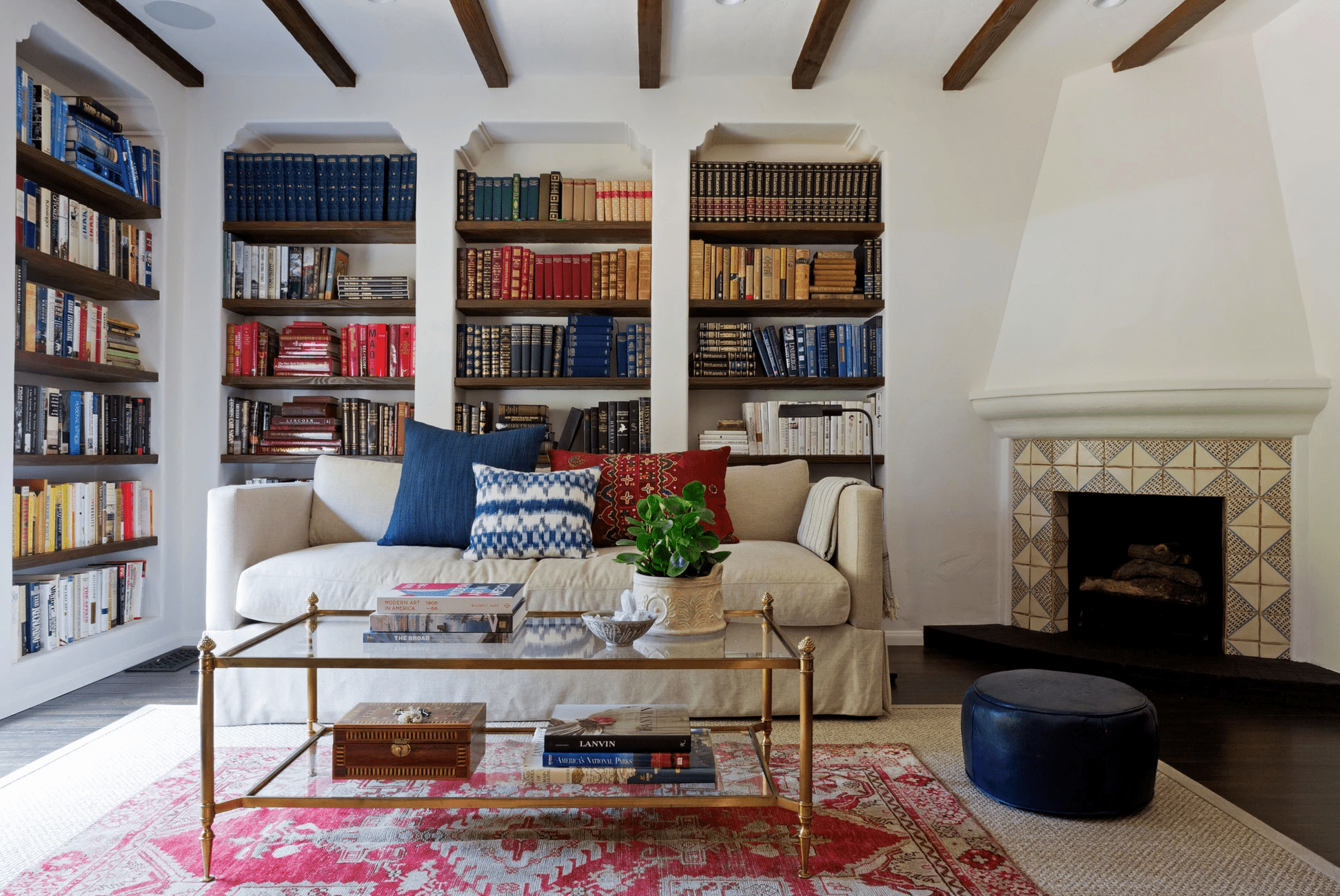 Home library with layered rugs.