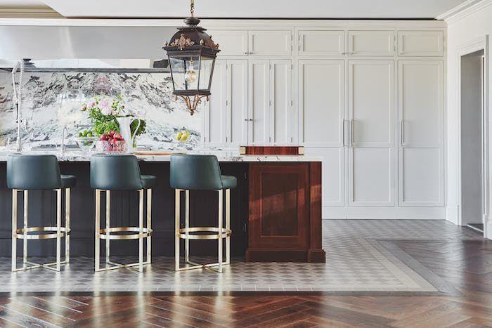 modern kitchen with white and black cabinets, marble backsplash