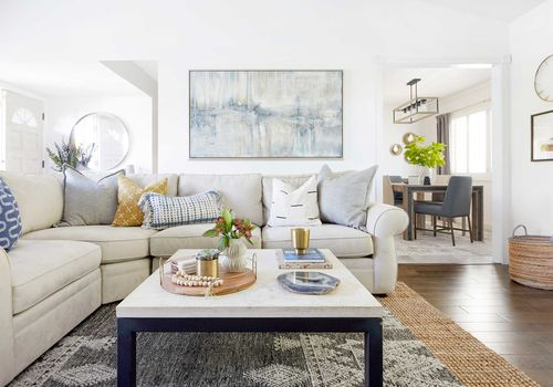 Living room with soft blue art piece.