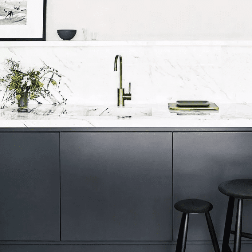 Minimalist kitchen with charcoal cabinetry and sconced lights